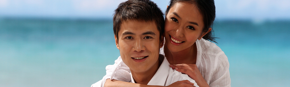 A shot of Young couple at the beachsmiling
